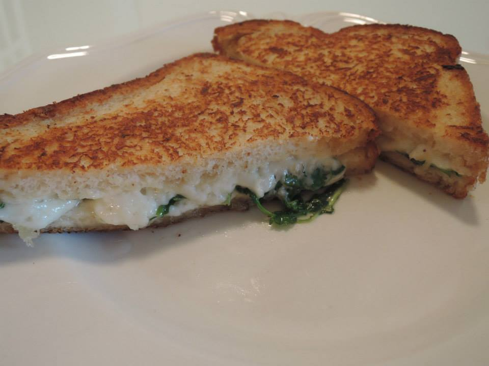 Made with sourdough bread, drunken goat cheese, baby arugula, butter ...